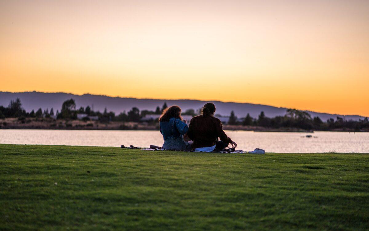 a couple by a lake
